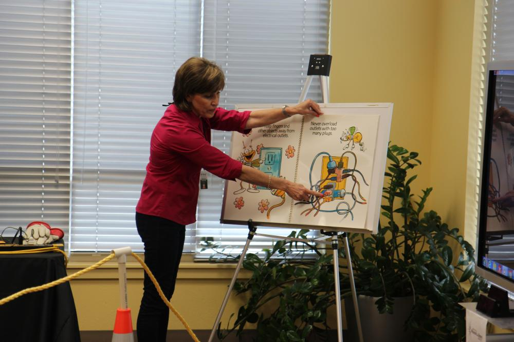 Catherine Poppe teaches electric safety using Louie the Lightning Bug